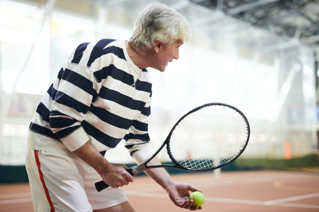 Aged tennis player